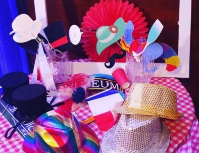 table with lot of fun props for photobooth